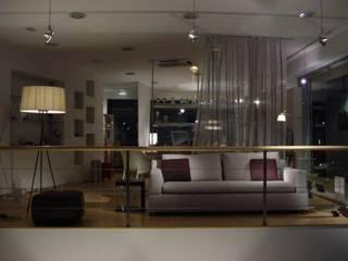 loja d106 interiores e d106 iluminaçao : Lojas e espaços comerciais  por d106,Minimalista