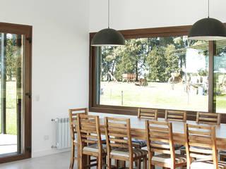 Casa CL: Comedores de estilo  por BAM! arquitectura
