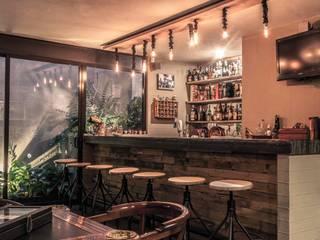 Bar: Salas de estilo  por Loyola Arquitectos