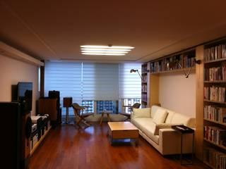 Salas modernas de 디자인 컴퍼니 에스 Moderno