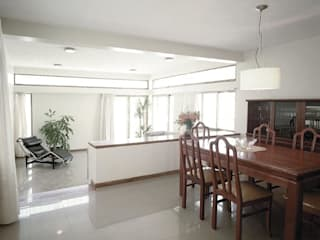 Casa Laura Siena Casas de estilo tropical de PA - Puchetti Arquitectos Tropical