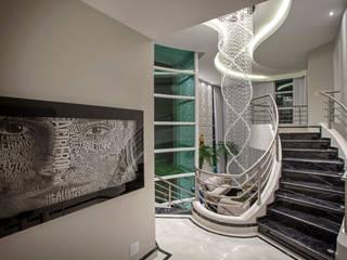Casa Tripoli: Corredores e halls de entrada  por Arquiteto Aquiles Nícolas Kílaris,Moderno Mármore
