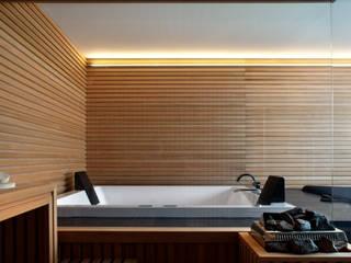 Spa de estilo  por MIDE architetti