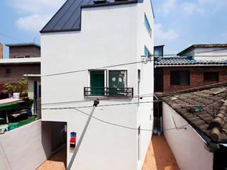 Modern houses by 토맥건축사사무소 Modern
