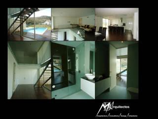 MORADIA RIBEIRA: Corredores e halls de entrada  por MDArquitectos,Moderno