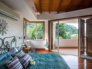Casa Horto OBM 79: Quartos  por Maria Claudia Faro