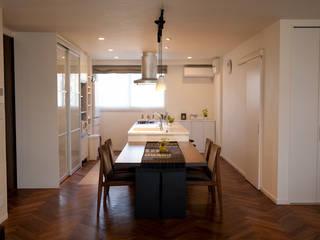 芦屋市S様邸: デザインスタジオ グランキューブが手掛けたダイニングです。