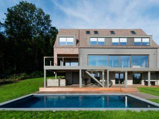 Transformation d'une habitation Maisons modernes par BURO 5 architectes et associés Moderne