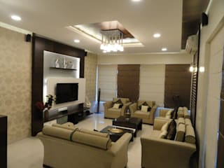 Amanora:  Living room by MAVERICK Architects