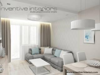 Jasny beżowy salon Nowoczesny salon od Inventive Interiors Nowoczesny