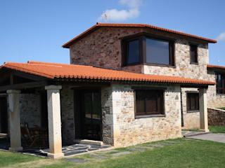 Country style house by Construcciones F. Rivaz Country
