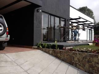 Casas estilo moderno: ideas, arquitectura e imágenes de Andrés Hincapíe Arquitectos A H A Moderno
