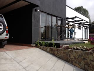 Nowoczesne domy od Andrés Hincapíe Arquitectos A H A Nowoczesny