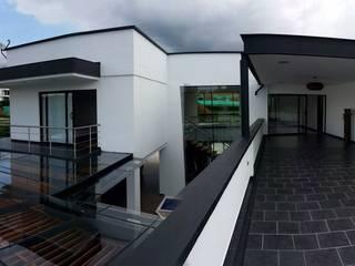 Casa L - La Pradera: Terrazas de estilo  por Andres Hincapie Arquitectos
