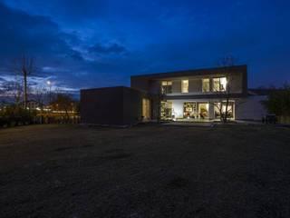 Casa B+A: Case in stile  di Green Studio architettura + design