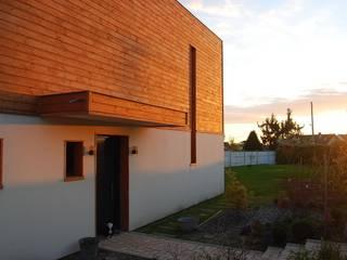 Maison ossature bois Maisons modernes par SARA Architecture Moderne