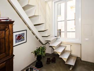 Realizzazioni Ingresso, Corridoio & Scale in stile moderno di A-LAB Arch. Marina Grasso Moderno