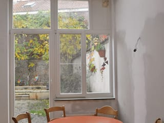 Extension d'une maison unifamiliale à Ixelles: Cuisine de style  par Responsible Young Architects sprl