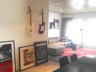 Apartamento do Rock Salas de estar modernas por elen saravalli arquitetura & design Moderno