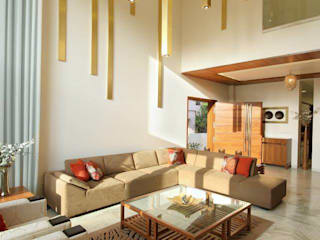 Mr.Rajan's Bungalow Modern living room by P & D Associates Modern