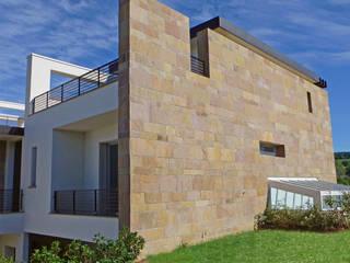 Abitazione a Sassofeltrio (PU): Case in stile in stile Moderno di STUDIO GRASSI