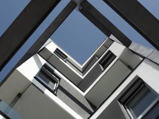Leche Park Residence: Case in stile  di Mino Caggiula Architects