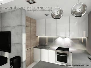Cozinhas industriais por Inventive Interiors