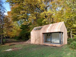 Casas modernas por ecospace españa Moderno Madeira Acabamento em madeira