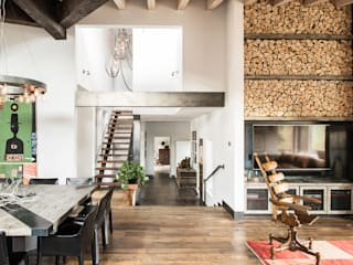 Truckee Residence: Salas de estar ecléticas por Antonio Martins Interior Design Inc