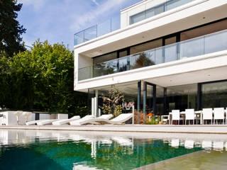 Modern Houses by WUNSCHHAUS Modern