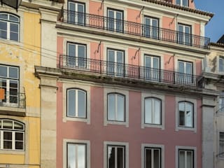Edifício Chinesas Milagrosas - Vista exterior da fachada principal: Casas  por Posto9 Arquitectos,Moderno
