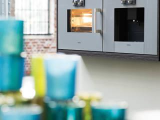 See some of our German branded kitchens! Effortless style for your dream kitchen! Nhà bếp phong cách hiện đại bởi PTC Kitchens Hiện đại