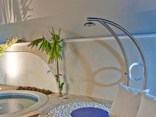 Casa Orquídea: Piscinas  por Arquiteto Aquiles Nícolas Kílaris