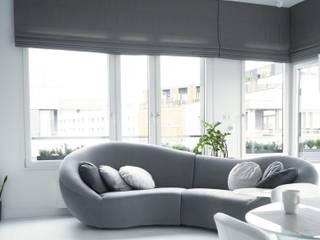 osiedle Ażurowych Okiennic: styl , w kategorii Salon zaprojektowany przez GocaDesign,