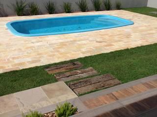 Casa no Alphaville Gravataí: Casas  por Fabris Franco Arquitetura,Moderno