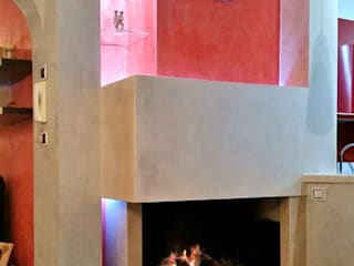 Camino prefabbricato rivestito Sala da pranzo moderna di Arch. Gianpiero Conserva Moderno
