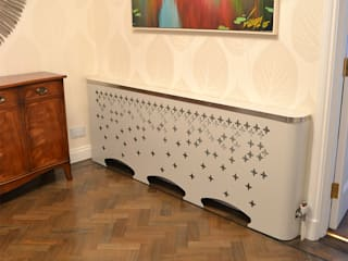 Ultra modern design of a bespoke radiator cover with a falling laser cut pattern:   by Laser cut Furniture & Screens