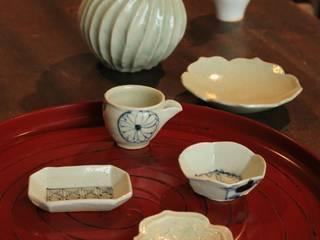 小人の器で宴: 吉田崇昭が手掛けたです。