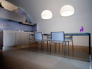 Realizzazioni: Sala da pranzo in stile  di antonio pelella + fabrizia costa cimino