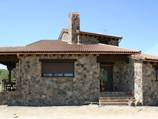 Fachada principal: Casas de estilo  de Arq0