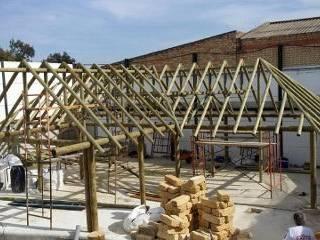 UN OASIS DE JUNCO AFRICANO DE INTERIOR: Casas de estilo  de GRUPO ROMERAL