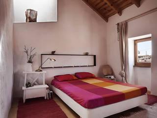 Schlafzimmer von pedro quintela studio, Rustikal Stein