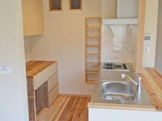 無垢のキッチン: むくむくはうすが手掛けたキッチンです。