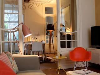 Décoration appartement 100m²: Salon de style  par Céline Masson