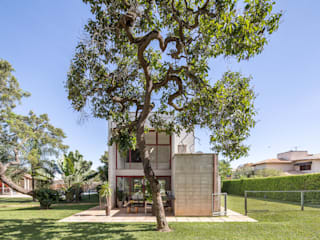 Joana França Casas de estilo industrial Concreto