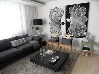 Alfredo Herrera Design: Salas de estilo  por Alfredo Herrera Design