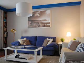 Renovación de salón con aire romántico: Salones de estilo  de UVE laboratorio de diseño