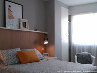Dormitorio de estilo nórdico: Dormitorios de estilo  de UVE laboratorio de diseño
