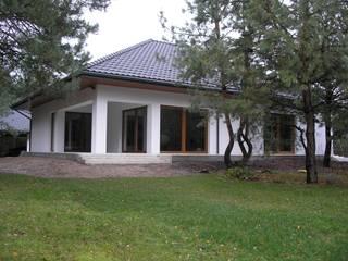 Nowoczesny dom LIV 3 G2 - przytulnie i pięknie!: styl , w kategorii Domy zaprojektowany przez Pracownia Projektowa ARCHIPELAG,Nowoczesny