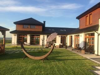 Dom Dionizy (mały) G2 - efektowny, elegancki i bardzo przytulny Nowoczesne domy od Pracownia Projektowa ARCHIPELAG Nowoczesny